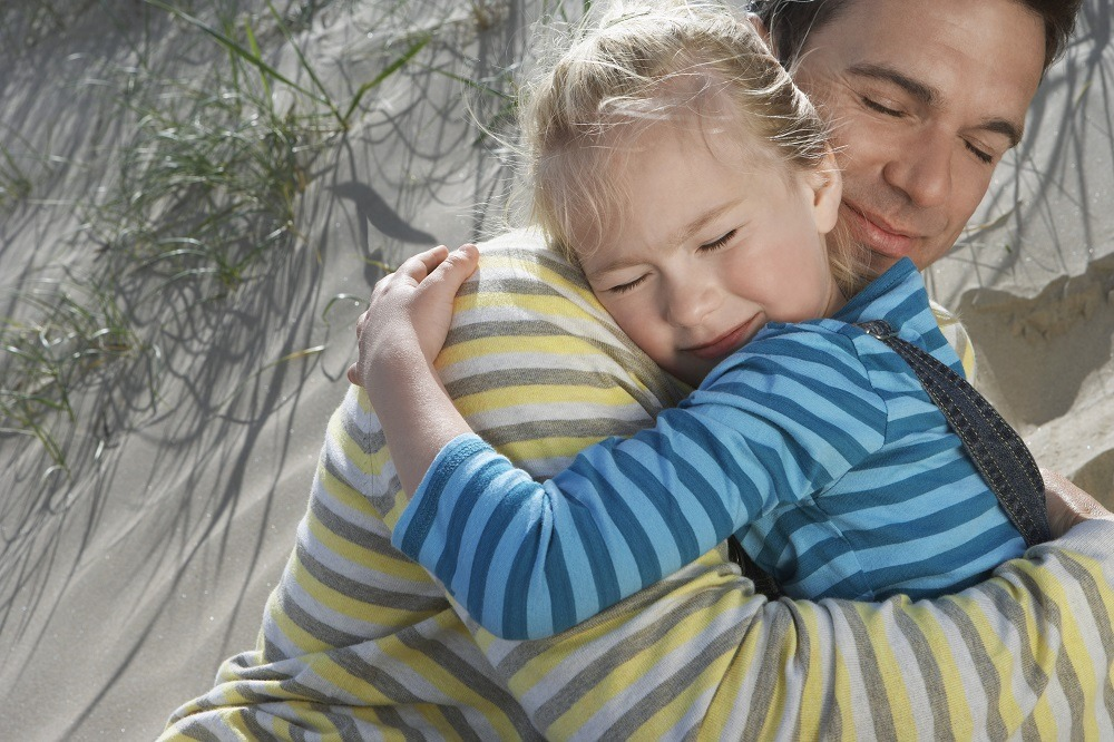 girl child hugging her father